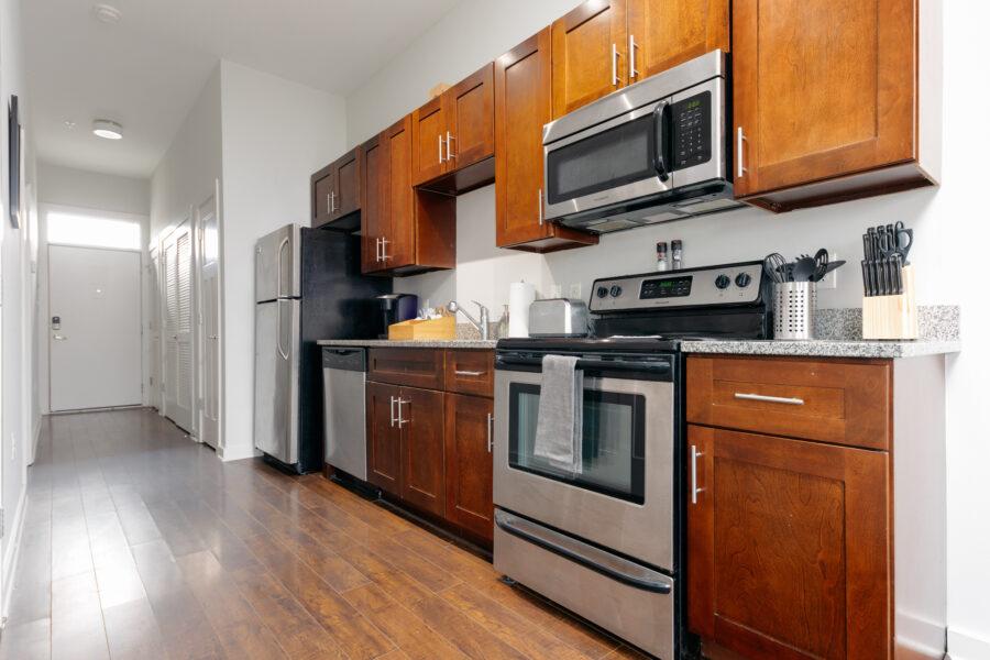 Kitchen with oven, fridge and dishwasher